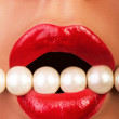 Sexy lips bitting jewellery in mouth — Stock Photo