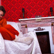 Smiling girl inside a red vintage room with christmas decoration — Stock Photo #32782747