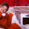 Smiling girl inside a red vintage room with christmas decoration — Stock Photo #32782765
