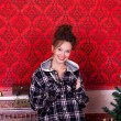 Girl in worm clothes inside a red vintage room with christmas de — Stock Photo #32782835