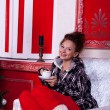 Girl in worm clothes inside a red vintage room with christmas de — Stock Photo #32782857