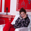 Girl in worm clothes inside a red vintage room with christmas de — Stock Photo #32782865