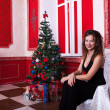 Gorgeous girl in evening dress in red vintage room with christma — Stock Photo #32782885