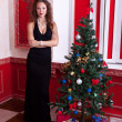 Gorgeous girl in evening dress in red vintage room with christma — Stock Photo #32782929