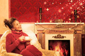 Vintage marry christmas card with a smiling girl in a red room — Stock Photo