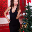 Beautiful woman in evening dress next to christmas tree — Foto de Stock