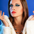 Sexy woman in winter fur on blue background fashion glamour styl — Stock Photo