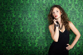 Beautiful gorgeous model posing in green vintage room — Stock Photo