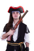 Pirate with a retro gun in hand on white — Stock Photo