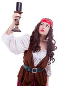 Pirate girl with a candle in hand — Stock Photo