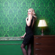 Retro style dress woman in vintage green room — Stock Photo #43656921