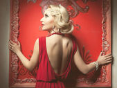 Artistic image of retro woman red dress rich interior — Stock Photo