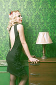 Woman in vintage room toned image — Stock Photo
