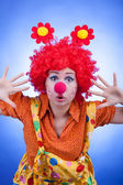 Clown woman on blue background studio shooting — Foto Stock