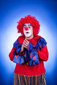 Smiling clown on blue background studio shooting — Stok fotoğraf