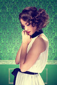 Gorgeous woman vintage toned image in retro room — Stock Photo