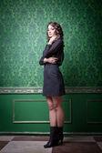 Sensual woman in green retro room — Stock Photo