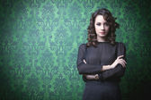 Beautiful woman in green vintage room — Stock Photo