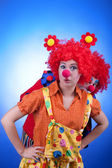 Clown couple in costumes on blue background — Stock Photo