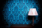 Old lamp in blue vintage interior — Stock Photo