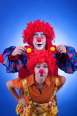 Two happy clowns playing on blue background — Foto de Stock