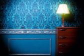Vintage lamp in retro blue toned interior — Stock Photo