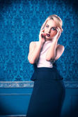 Sensual woman on blue rococo wall — Stock Photo
