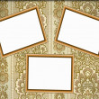 Royalty-Free Stock Photo: Three empty wooden  frames  on the wall