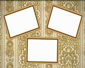 Three empty wooden frames on the wall — Stock Photo