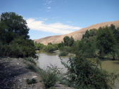 Stream on a plateau in mountains of Kyrgyzstan, Asia — Stock Photo