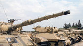 Old military tanks built abreast — Stock Photo
