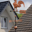 Gold Weathercock on the roof - Stock Photo