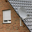 Stock Photo: Satellite dish on the roof