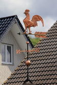 Gold Weathercock on the roof — Stock Photo