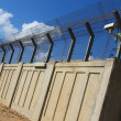 Stock Photo: Secured industrial zone with concrete fence