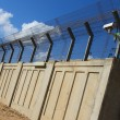Secured industrial zone with concrete fence — Stock Photo #15869947