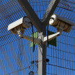 Stock Photo: Secured industrial zone with Security camera