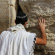 Jewish worshiper pray at the Wailing Wall an important jewish religious site   in Jerusalem, Israel. - Stok fotoğraf