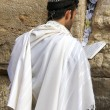 Jewish worshiper pray at the Wailing Wall an important jewish religious site   in Jerusalem, Israel. - Stock Photo