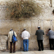 Jewish worshipers  pray at the Wailing Wall an important jewish religious site   in Jerusalem, Israel. - Stok fotoğraf