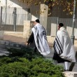 Unidentified religious Jews go from  the synagogue - Stock Photo