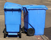 Blue garbage cans — Stock Photo