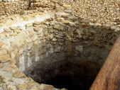 Antique artificial stone cistern for collecting water — Stock Photo