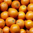 Bunch of fresh  oranges on market. Selective focus - Stockfoto