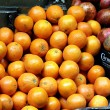 Bunch of fresh  oranges  and Pomegranades  on market. Selective focus - Stockfoto