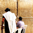 Unidentified jewish men praying at the Wailing wall (Western wall) - Stock Photo