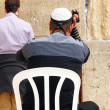 Unidentified jewish men praying at the Wailing wall (Western wall) — Stockfoto #22199337
