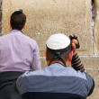 Unidentified jewish men praying at the Wailing wall (Western wall) — Stockfoto #22199349