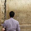 Stock Photo: Unidentified young mpraying at Wailing wall (Western wall)