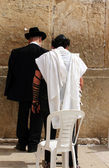 Unidentified man in tefillin and orthodox are praying at the Wailing wall (Western wall) — Zdjęcie stockowe